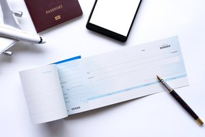 el cheque de viaje
