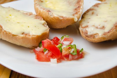 toast topped with beans and melted cheese