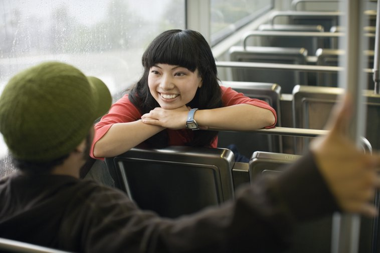 couple chatting on a train
