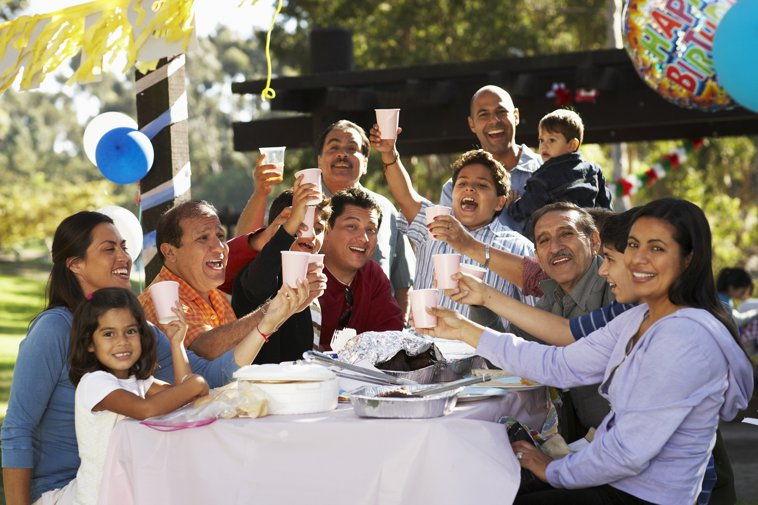 latino family toasting at a barbecue