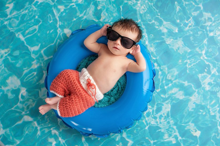 cool baby relaxing in a pool